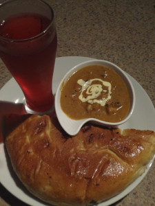 Butter chicken with Naan and a glass full of black current drink :)