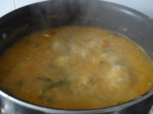 Rice and dal were cooking by placing a lid on it